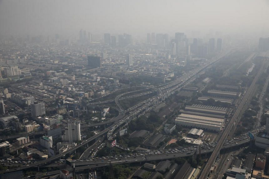 Vehicles travel along highways as buildings stand shrouded in smog in Bangkok, Thailand, on Jan 25, 2019.