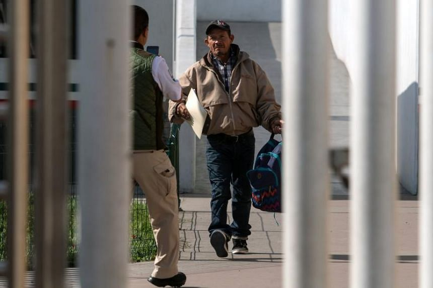 Carlos Catarlo Gomez, an asylum seeker from Honduras, returns to Mexico from the United States while his case is processed by US authorities, at El Chaparral crossing port on the US-Mexico border, on Jan 29, 2019.