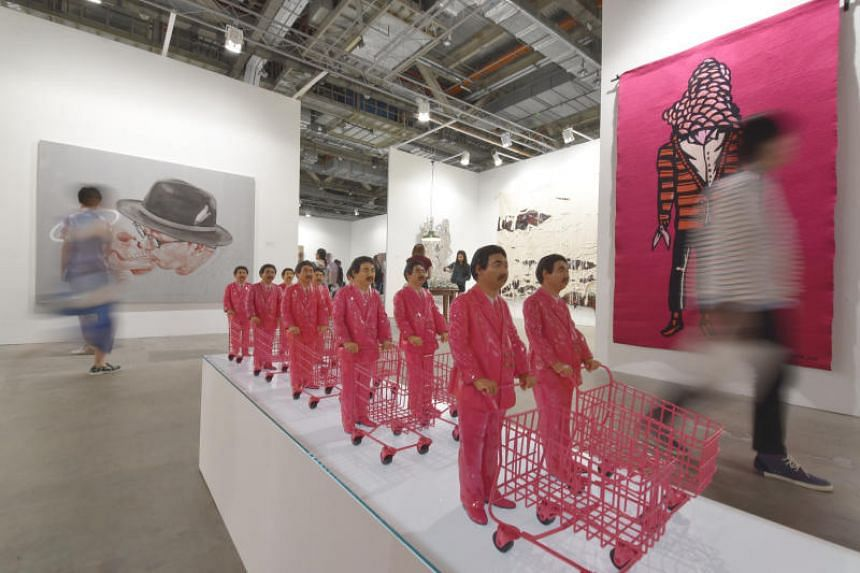 Pink Men Vs Pink Buddha by Manit Sriwanichpoom at the eighth edition of Art Stage Singapore held at Sands Expo And Convention Centre.