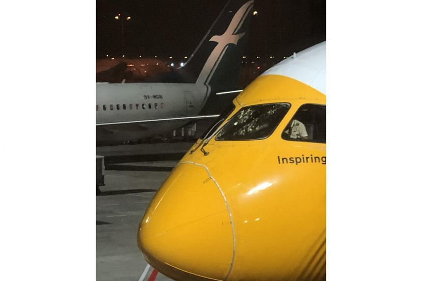 Flight TR6, which was carrying 341 passengers between Singapore and Gold Coast, sustained some damage on the exterior of the front windshield.