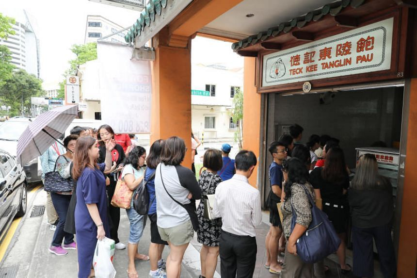 A queue at the Killiney Road outlet for their soon-to-be last chances to have the Teck Kee Tanglin Pau. By 1.30pm, over a thousand of their iconic char siew pau were sold.