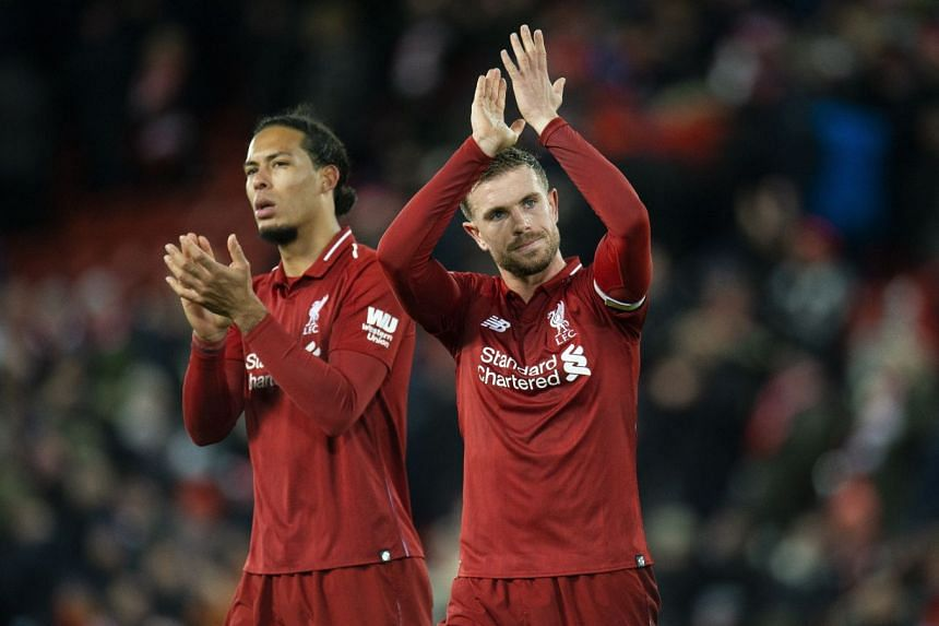 Liverpool's Jordan Henderson reacts with Virgil Van Dyke after the match.