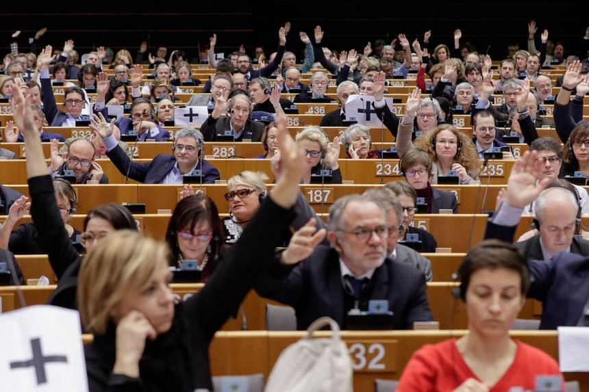 Lawmakers voting during a plenary session at the European Parliament in Brussels, Jan 31, 2019.