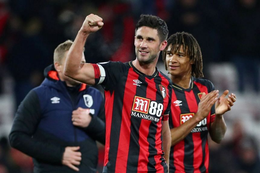 Bournemouth's Andrew Surman celebrates after the match.
