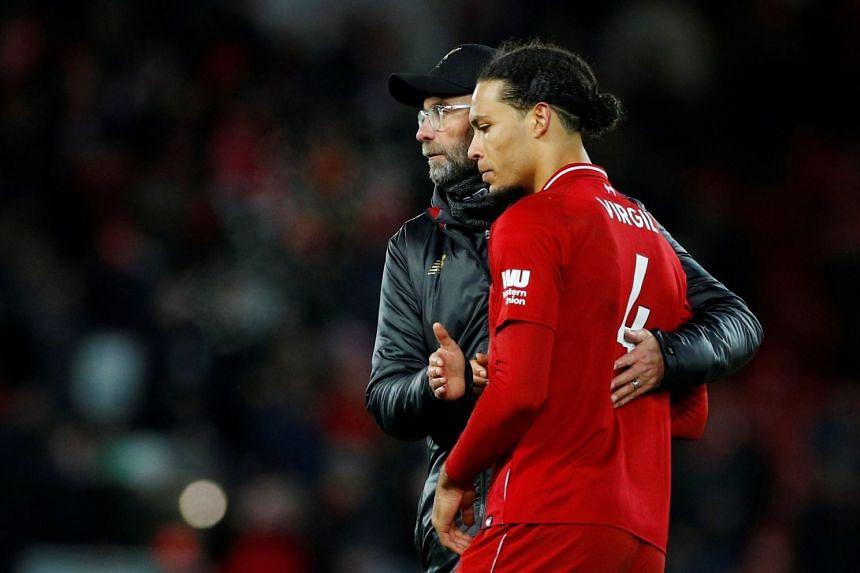 Liverpool manager Juergen Klopp speaks with Liverpool's Virgil van Dijk after the match.