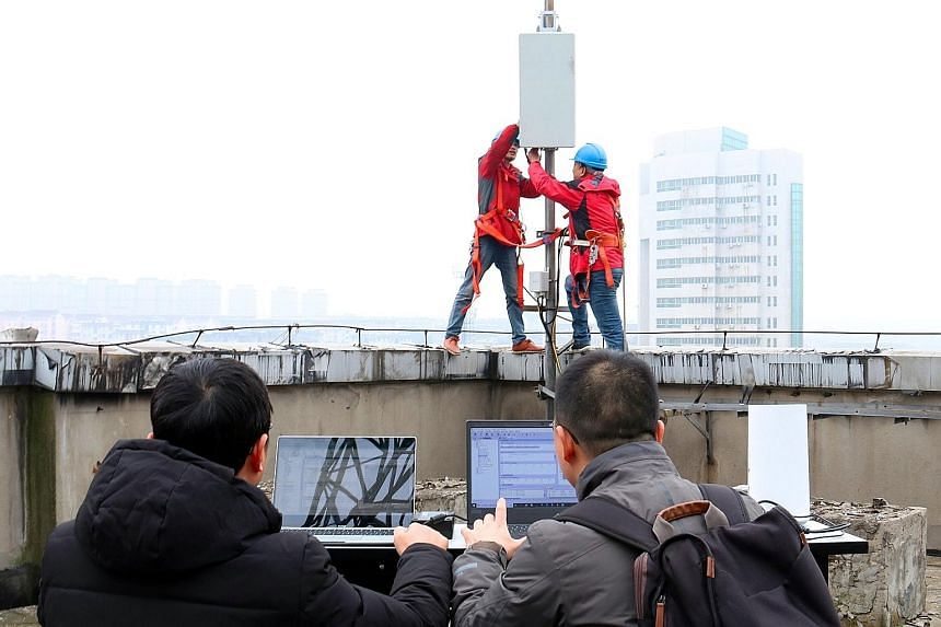 China Unicom technicians testing the equipment at a newly built 5G network base station in Tongling, Anhui province, on Tuesday. China said the first commercial 5G smartphones are likely to become a reality this year.