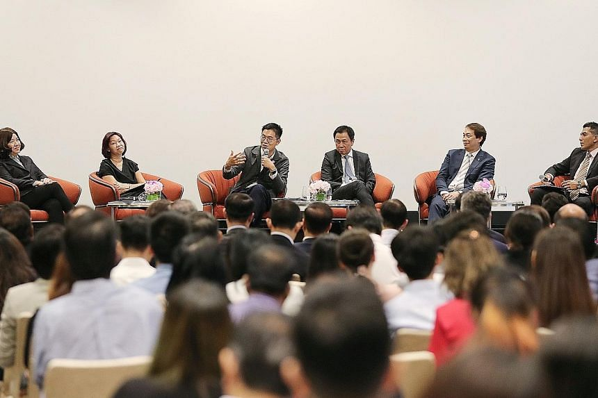 (From left) Ms Vanessa Ng, senior vice-president of human resources, Singapore Airlines; Ms Kathy Lai, deputy chief executive officer, Enterprise Singapore; Mr Chng Kai Fong, managing director, Economic Development Board; Mr Chaly Mah, chairman, Sing