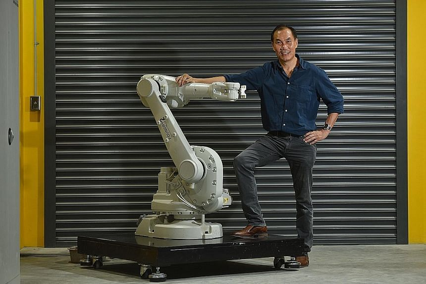 Below: Associate Professor Tan Ming Jen with a 3D robotic concrete spray printer that can print concrete. He is studying ways to improve concrete printing. Left: HP's Mr Rob Mesaros with items that have been produced using a 3D printer, for example,