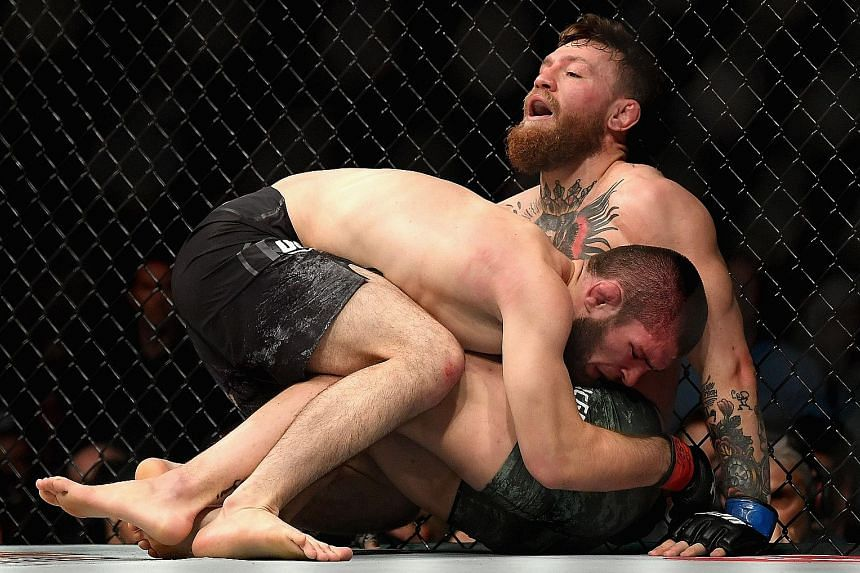 Khabib Nurmagomedov of Russia holding down Conor McGregor of Ireland in their UFC lightweight championship bout during UFC 229 in Las Vegas in October last year.