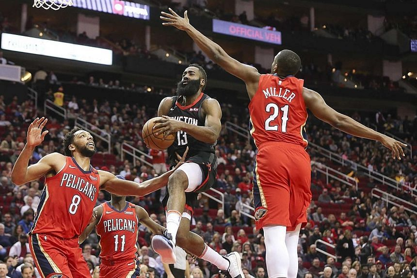Houston Rockets' James Harden splitting the defence of the New Orleans Pelicans' Jahlil Okafor (left) and Darius Miller at Toyota Centre on Tuesday. The guard had 37 points to average 43.6 for January.