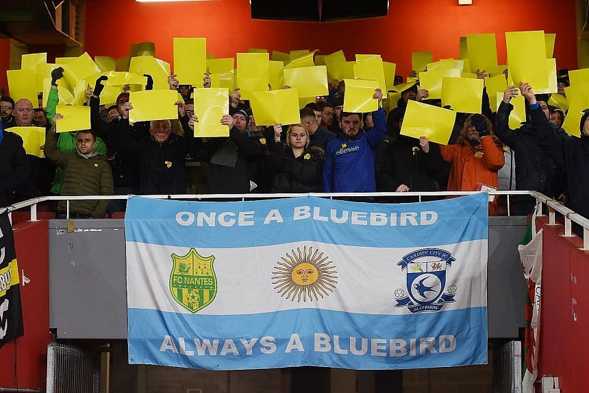 Cardiff City supporters display tributes for Argentinian forward Emiliano Sala ahead of the Premier League match against Arsenal at the Emirates Stadium on Tuesday. Also, a minute's reflection was held before kick-off.