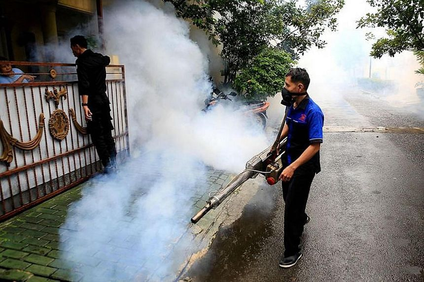 A worker spraying insecticide in Bintaro, South Tangerang, last Thursday. To control the dengue outbreak, Indonesia has distributed larvicide and fogging equipment to affected areas.