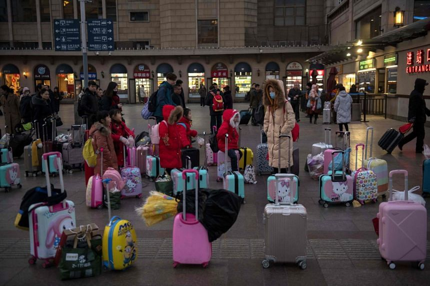 People wait outside the Beijing railway station before taking trains ahead of Chinese New Year on Jan 29, 2019.