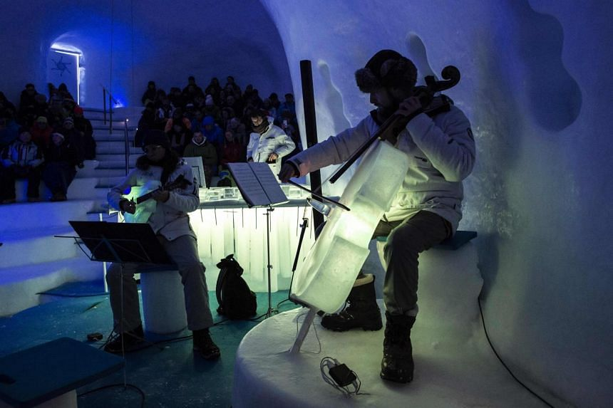 """Musicians perform with ice instruments during a concert in the """"Ice Dome"""" on Presena Galcier, Tonale Pass, near Trento in northern Italy on Jan 17, 2018."""