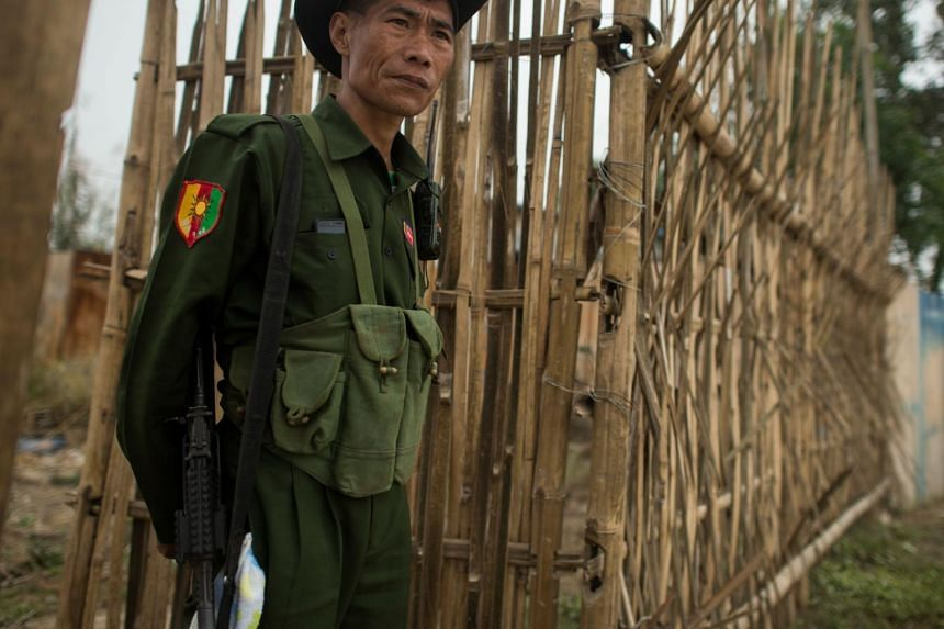 An armed Pan Say militiaman guarding an area in the Shan state border town of Muse on Jan 12, 2019.