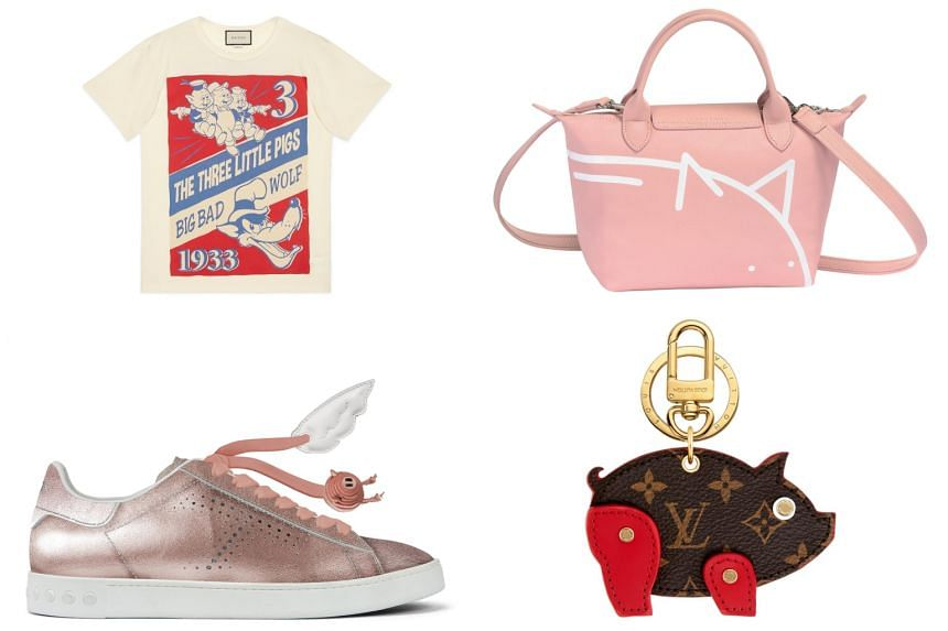 (Clockwise from top left:) T-shirt with three little pigs and big bad wolf from Gucci, Mr Bags x Longchamp Le Pliage Cuir top handle bag from Longchamp, pig bag charm and key holder from Louis Vuitton, limited edition sneakers from Tods.