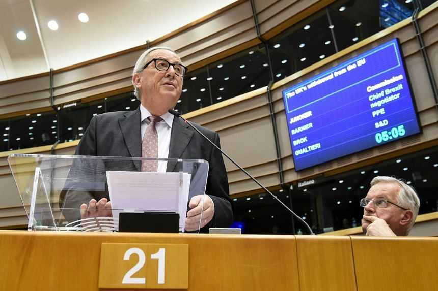 Juncker (left) speaking at a session of the EU parliament in Brussels on Jan 30, 2019.