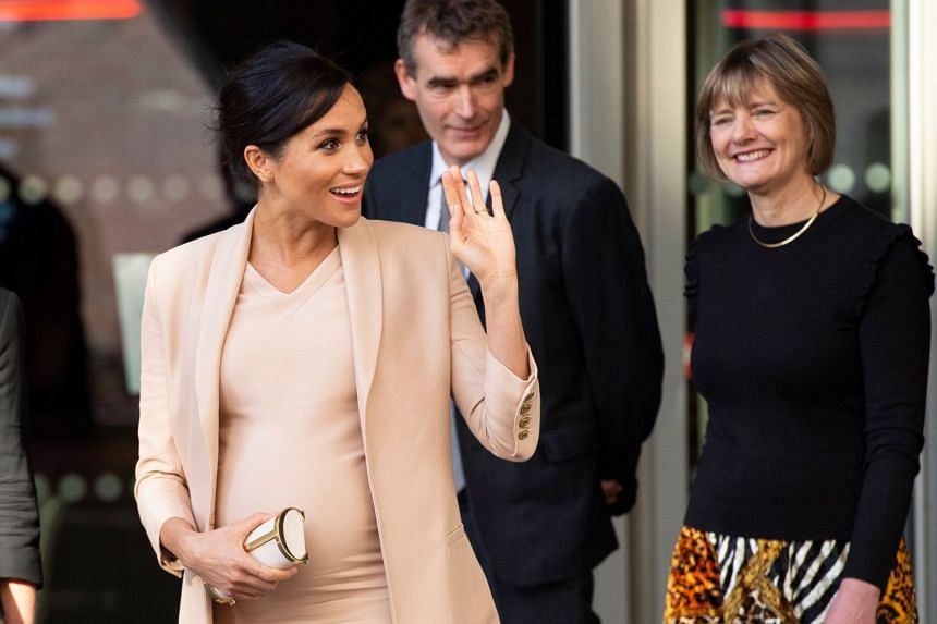Meghan, Duchess of Sussex waves after visiting the National theatre in central London.