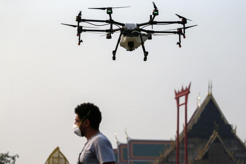 A drone sprays water during an operation to reduce air pollution in Bangkok on Jan 31, 2019. Bangkok has been blanketed in a murky haze for weeks, drawing criticism from the public over the government's response.