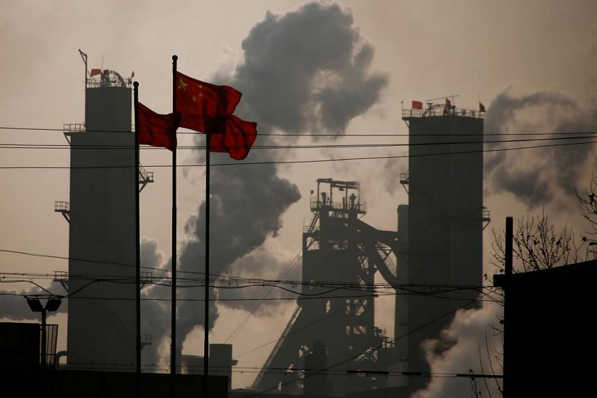 Chinese national flags flying near a steel factory in Wu'an, Hebei province, China, on Feb 23, 2017.