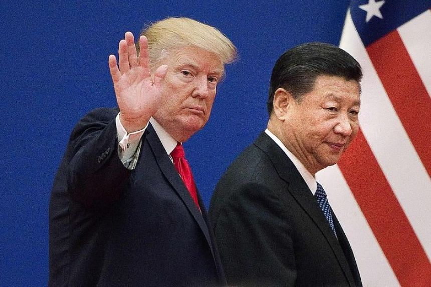 US President Donald Trump and Chinese President Xi Jinping at a business leaders event at the Great Hall of the People in Beijing, in a photo taken in November 2017.