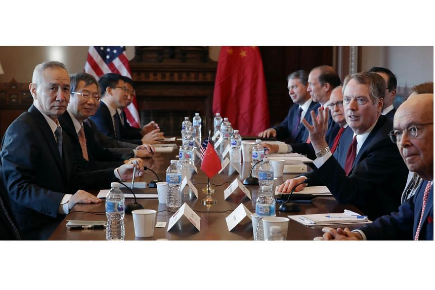 US Commerce Secretary Wilbur Ross (right), Trade Representative Robert Lighthizer (second from right) and top US officials sitting down with (from left) Chinese Vice-Premier Liu He, central bank governor Yi Gang and other Chinese vice-ministers and s