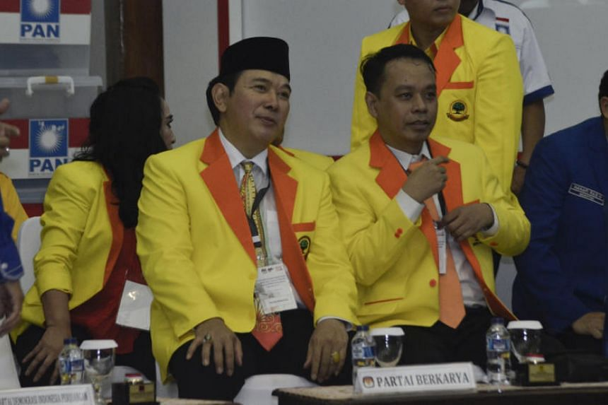 Tommy Suharto (left), son of the late Indonesian president Suharto, is running for a seat in restive Papua province despite a 2002 conviction for ordering the assassination of a Supreme Court judge.