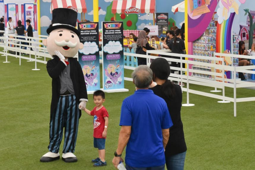 A child poses with mascot Mr Monopoly at the Toybox Powered by Hasbro carnival.