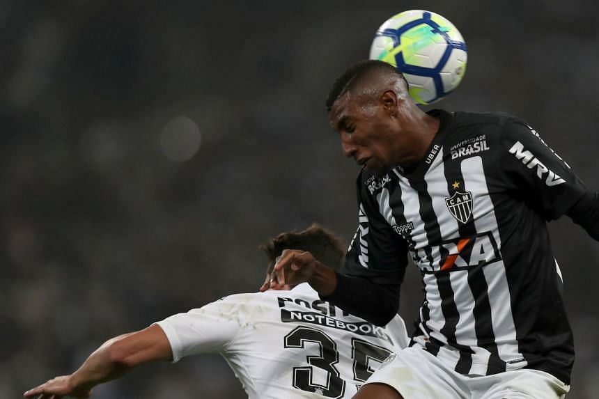 Atletico Mineiro's Emerson (right) in action.