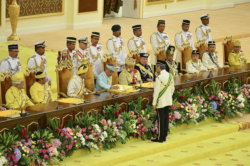Sultan Abdullah Ri'ayatuddin, (seated, fourth from left) signing a document before Malaysia's Conference of Rulers, comprising the nine rulers of the Malay-majority states and the four governors of the remaining states with no hereditary royal houses