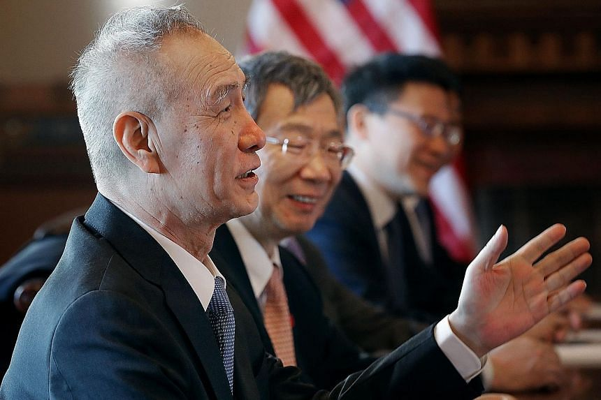 Chinese Vice-Premier Liu He (left), central bank governor Yi Gang (second from left) and members of a high-level trade delegation from China in discussions on Wednesday with US government ministers in Washington.