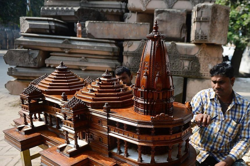 A model of the proposed Hindu temple to be built on the ruins of a mosque that was levelled by a mob in 1992, which sparked riots that killed about 2,000. The site is now under court control and guarded by armed police.
