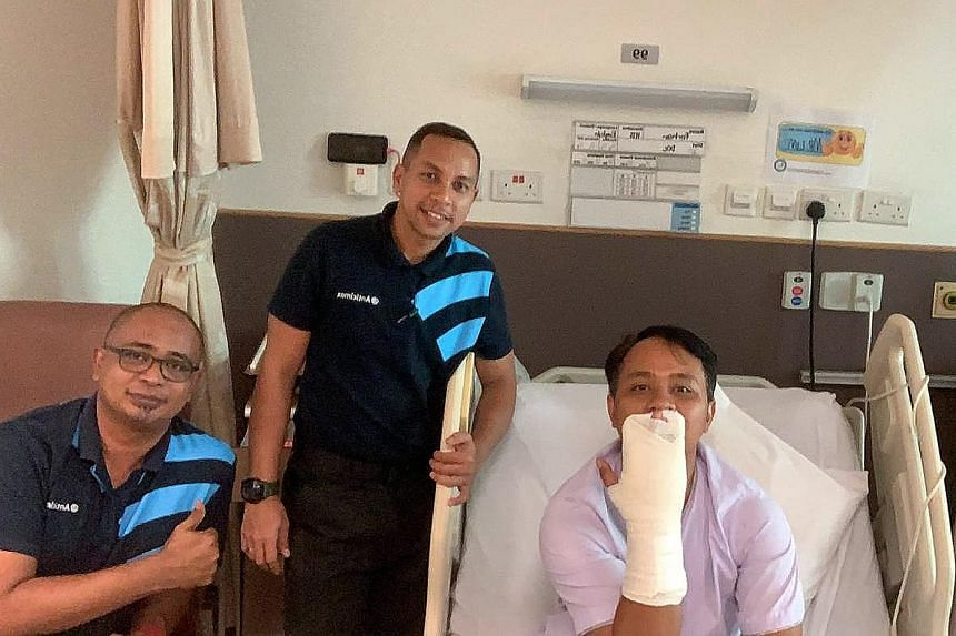 A pest control worker was bitten while capturing the python on Tuesday (above). The firm said yesterday the worker Farhan (left) had undergone surgery to remove an embedded snake tooth.