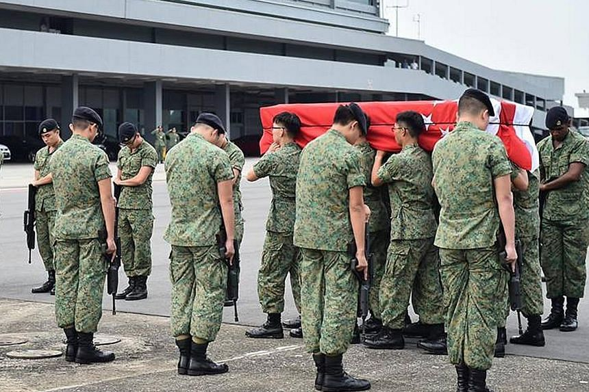 Gunners from the Artillery Formation paying their respects to Corporal First Class (NS) Aloysius Pang as servicemen carried his casket at Paya Lebar Air Base after his body was flown back to Singapore from New Zealand on Jan 25.