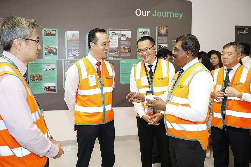 Senior Minister of State for Trade and Industry Koh Poh Koon with ST Logistics chief executive (designate) Loganathan Ramasamy during a tour yesterday of Toll City, a next-generation logistics hub in Tuas.