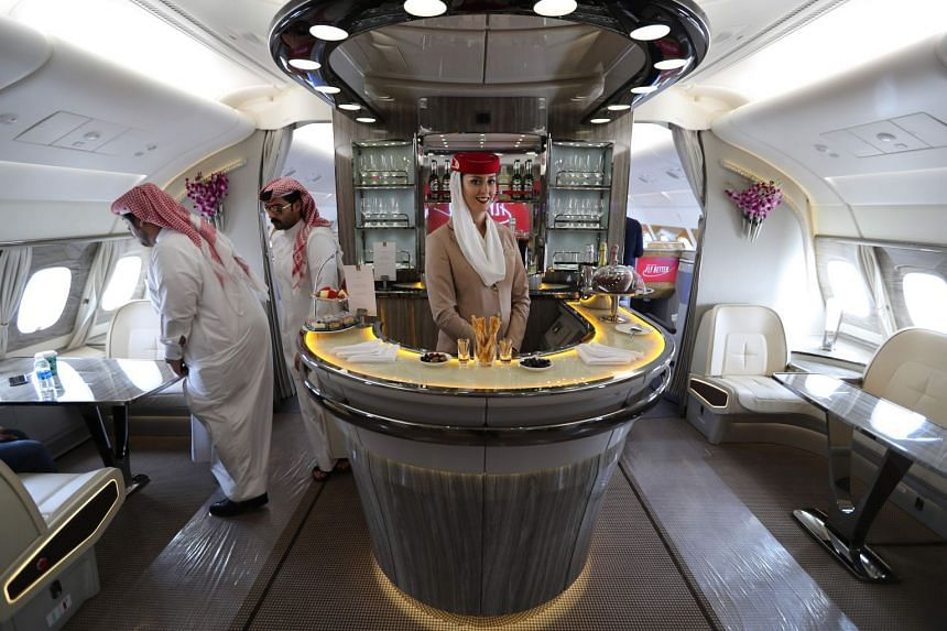 People walk inside the 100th Emirates double-decker Airbus A380 in November 2018.