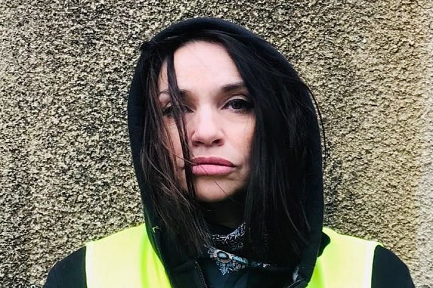 Beatrice Dalle wearing a yellow vest in a photo from her Instagram account.