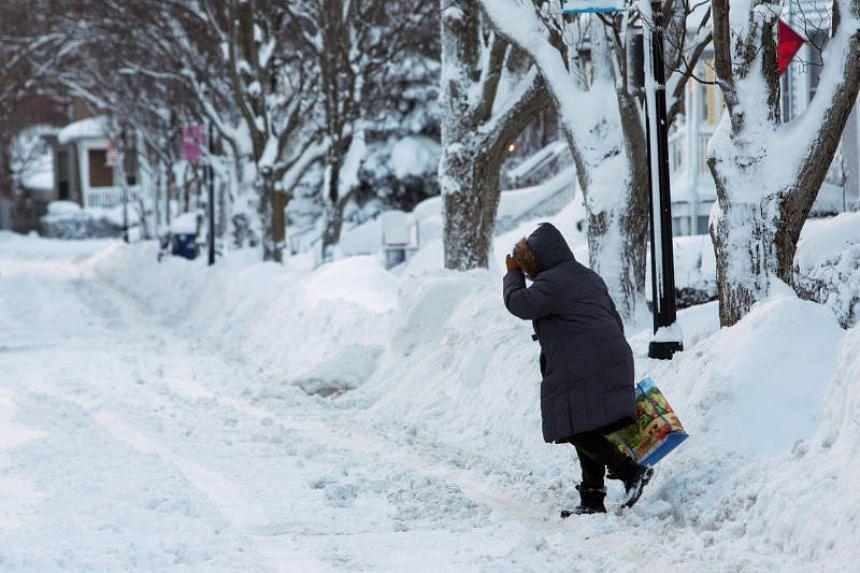 A woman walks in street after a winter storm in Buffalo, New York, on Jan 31, 2019.