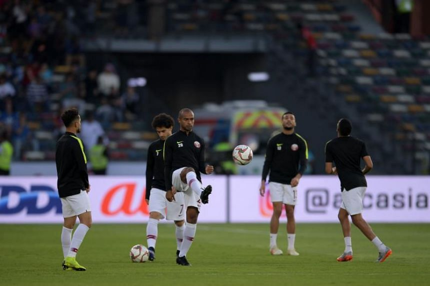 Qatar's players warming up ahead of the 2019 AFC Asian Cup final football match between Japan and Qatar at the Mohammed Bin Zayed Stadium in Abu Dhabi on Feb 1, 2019.