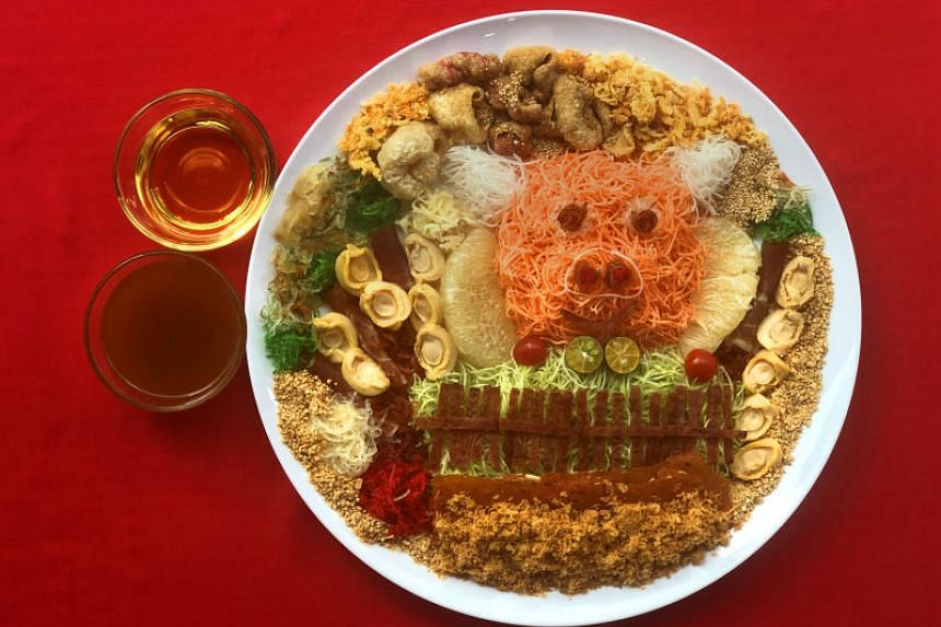 The use of different pork products adds to the texture of the dish, named Auspigcious Yusheng.