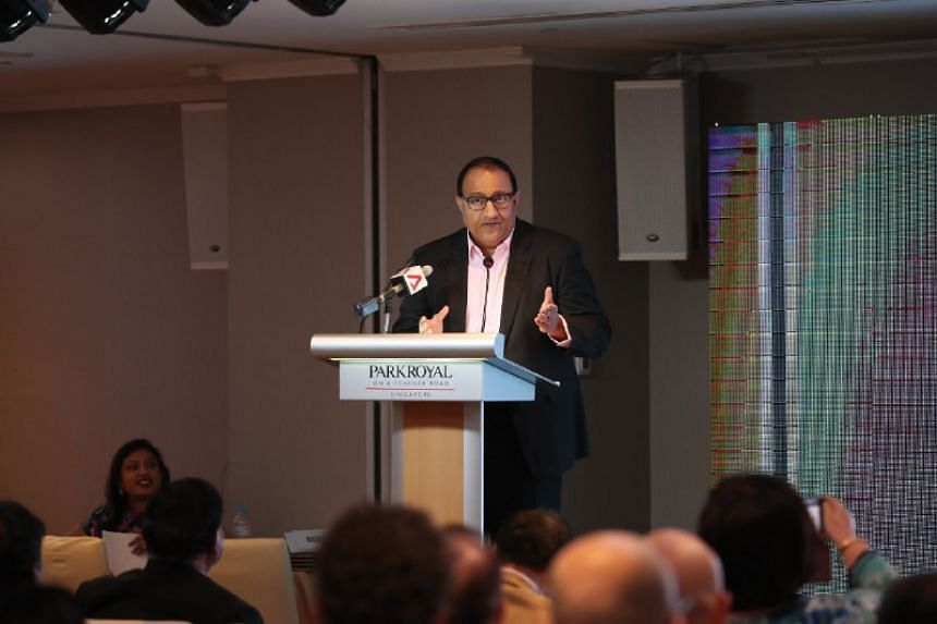 """The question for businesses today is no longer one of whether they should go digital, but """"when and how"""", Communications and Information Minister S. Iswaran said."""