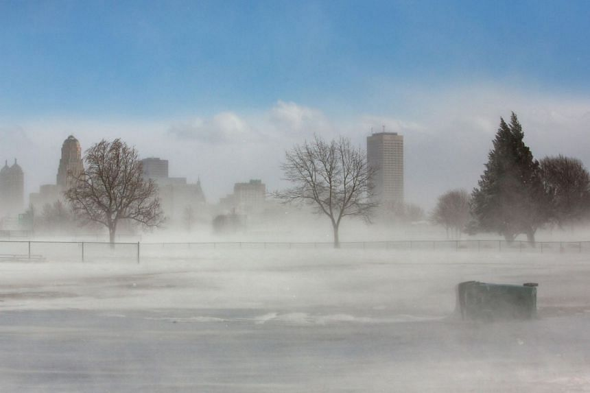 The city skyline is seen in drifting snow during the polar vortex in New York, US, on Jan 31, 2019.