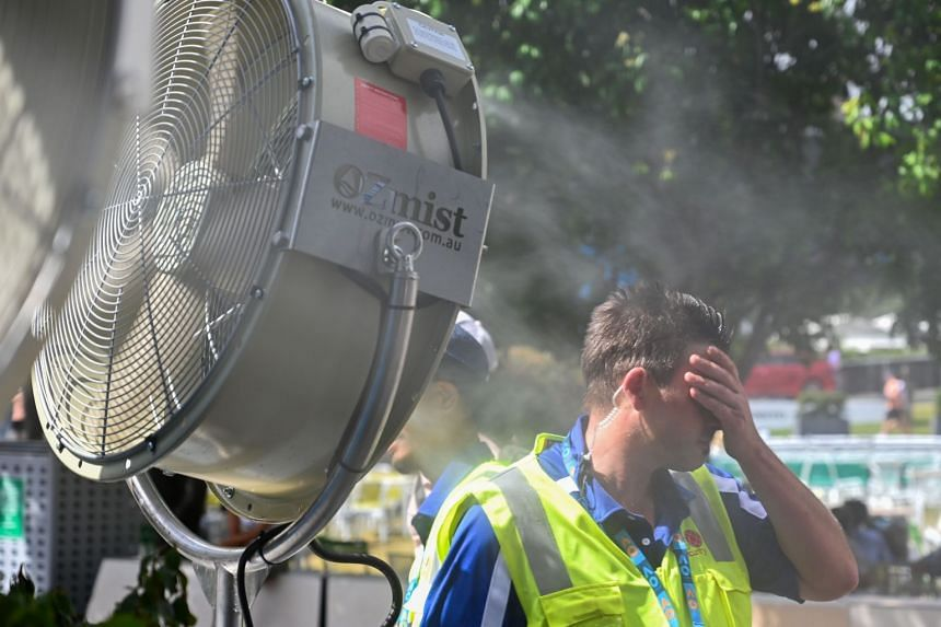 A man cools down in front of a mist fan during an Australian Open tennis tournament in Melbourne, on Jan 25, 2019.