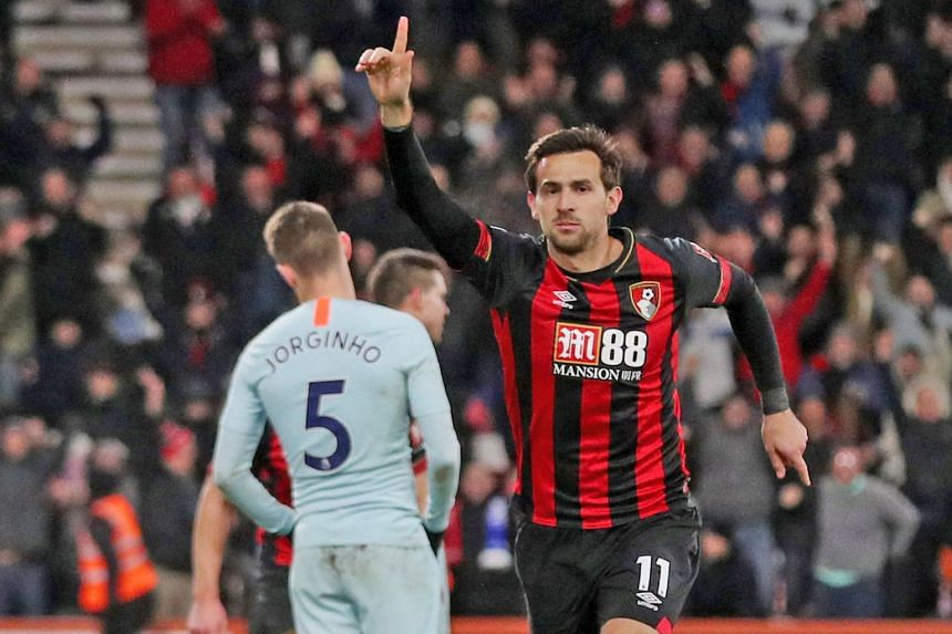 Bournemouth's Charlie Daniels celebrates scoring their fourth goal against Chelsea on Wednesday. The 4-0 win resulted in the Blues dropping out of the Premier League's top four on goal difference.
