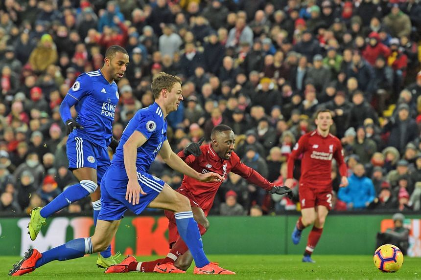 Liverpool's Guinean midfielder Naby Keita goes down in the area after a challenge from Leicester City's Ricardo Pereira (left) but referee Martin Atkinson refuses to give a penalty which frustrates Jurgen Klopp.