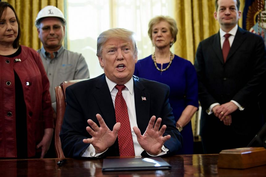 Trump speaking during an executive order signing in the Oval Office of the White House.