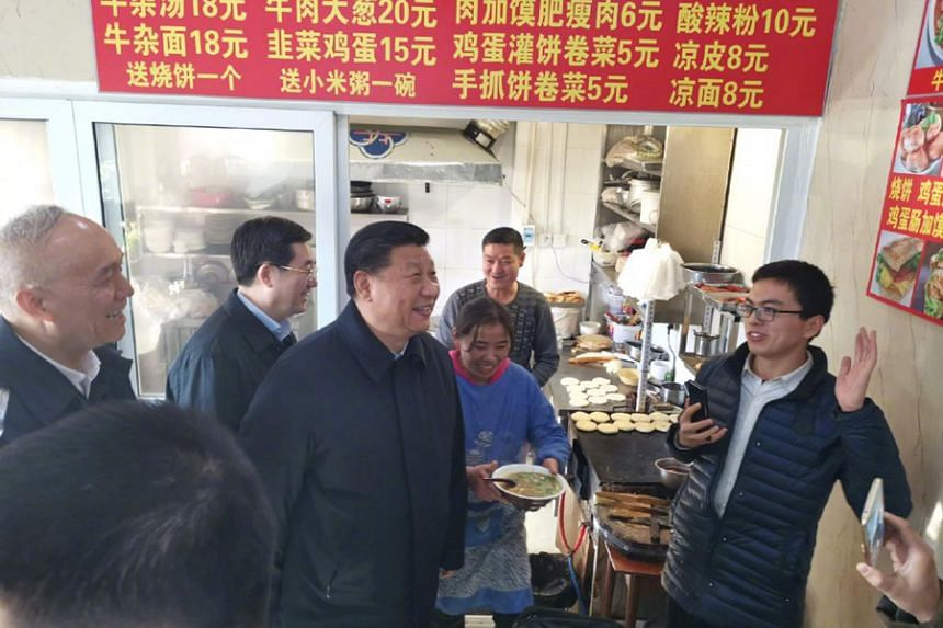 Mr Xi drops in on an eatery in a hutong, or alley, in Beijing during his walkabout on Friday (Feb 1).