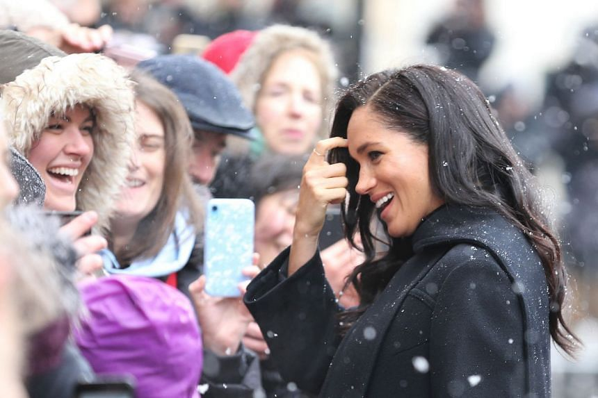 Britain's Meghan, Duchess of Sussex talks with residents as she arrives at Bristol Old Vic.