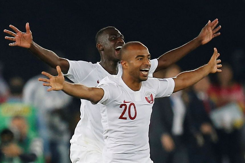 Qatar's Ali Afif and team mates celebrate winning the Asian Cup.