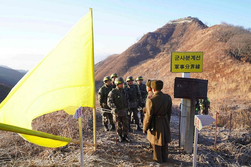 South Korean soldiers (left) being greeted by North Korean soldiers in Cheorwon county before crossing the Military Demarcation Line last December to inspect a dismantled North Korean guard post inside the Demilitarised Zone dividing the two Koreas.
